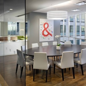 Oval shaped meeting table by Creative Wood in a modern office setting