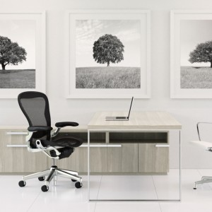 Rendering of chair, desk with open metal base, and credenza from Creative Wood's Zip office casegood collection